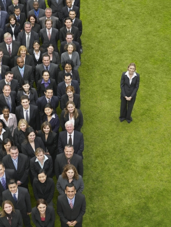 large formation: Business woman standing next to large group of business people in formation, elevated view, portrait LANG_EVOIMAGES