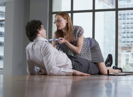 seducing: Woman seducing man on office floor
