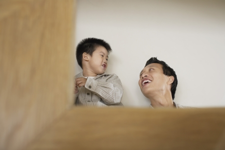 spiky hair: Smiling father and son playing LANG_EVOIMAGES