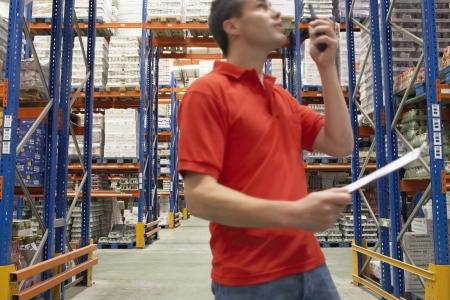 warehouse worker: Warehouse Worker Using Walkie-Talkie