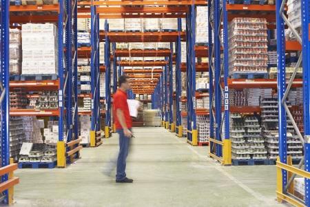 warehouse storage: Man Walking Through Warehouse side view