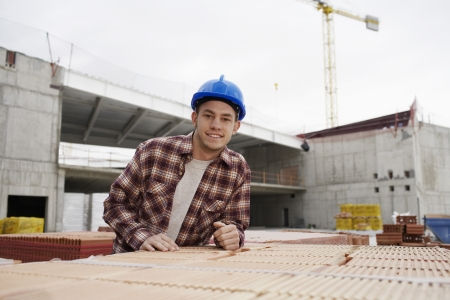 spaniards: Young construction worker on building site