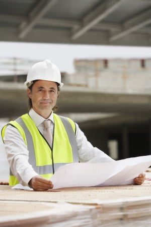 spaniards: Construction worker holding building plans