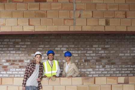 spaniards: Construction team on building site LANG_EVOIMAGES