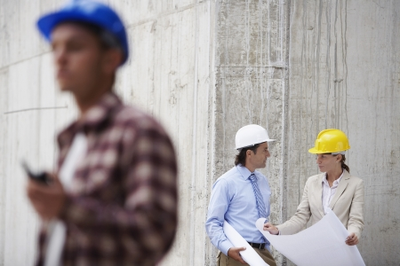 spaniards: Managers and worker on construction site