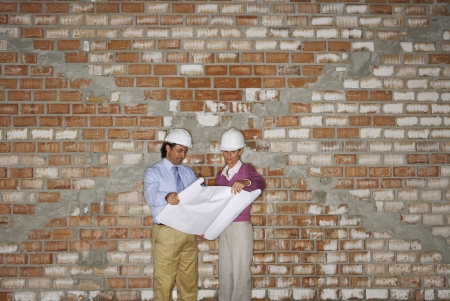 spaniards: Construction manager and architect examining plans