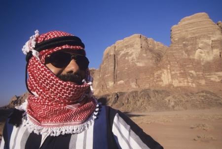 desert landscape: Arab Man in turban Wearing Sunglasses standing in desert landscape