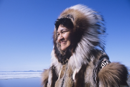 Smiling Eskimo Woman in Traditional Clothing