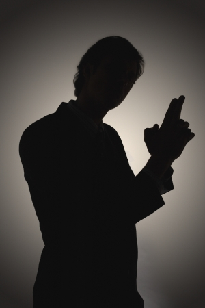 Shadow of man making gun-shaped gesture side view Stock Photo - 18897750