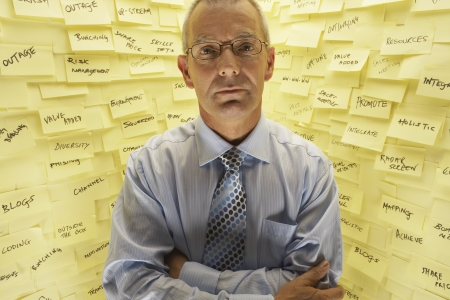 Businessman Standing at Wall with Post Its Stock Photo - 18897793