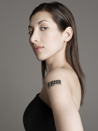 raised eyebrow: Young woman with bar code tattoo on her arm LANG_EVOIMAGES