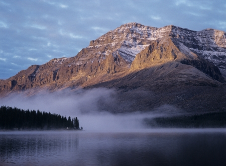 edith: Rocky mountain fog over lake sunset LANG_EVOIMAGES