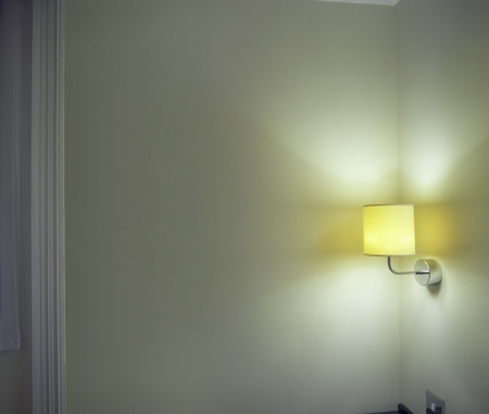 sconce: Sconce Shining Light onto Corner in Room
