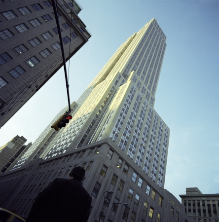 Man Walking by Empire State Building Stock Photo - 18898092