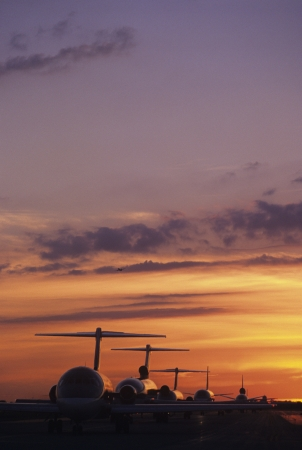 airport runway: Planes Sitting on Tarmac at Sunset LANG_EVOIMAGES