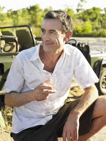 Portrait of adult man holding wineglass outdoors Stock Photo - 18898199
