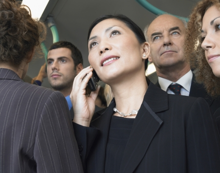 Businesswomen using mobile on train low angle view Stock Photo - 18898360