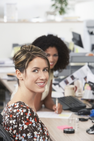 casually dressed: Casually dressed Businesswomen sitting in Office LANG_EVOIMAGES