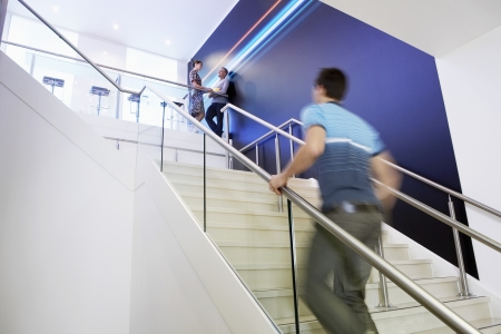 climbing stairs: Casually dressed Businessman Walking Up Stairs side view
