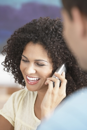 Businesswoman Using Cell Phone in Meeting Stock Photo - 18898467