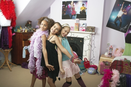 slumber: Young Girls striking a pose in trendy bedroom at Slumber Party LANG_EVOIMAGES