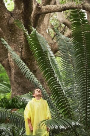 waterproof cape: Boy Standing by Large Fern