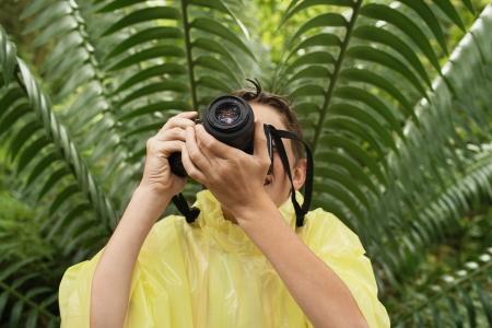 waterproof cape: Boy Taking Photos in Forest