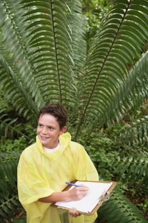 waterproof cape: Boy Writing in Forest