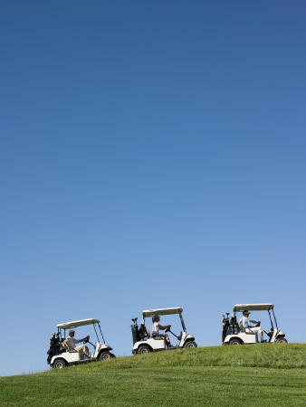golf cart: Golfers driving carts LANG_EVOIMAGES