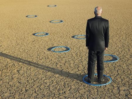 Businessman standing in hoops in desert back view full length Stock Photo - 18898968