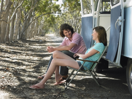 easygoing: Young Couple Resting on Road Trip