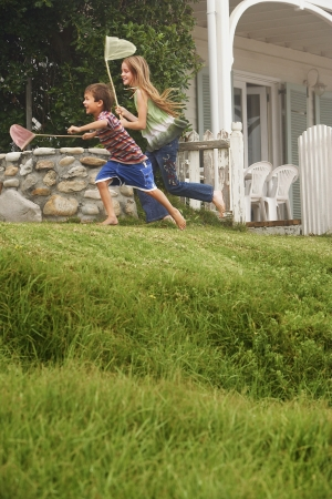 exaltation: Boy and Girl Running with Butterfly Nets