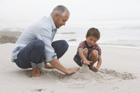 getting late: Father Playing with Son on Beach