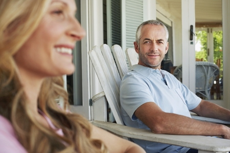 late forties: Couple Relaxing on Porch