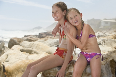 vacationer: Two Girls Embracing on Beach