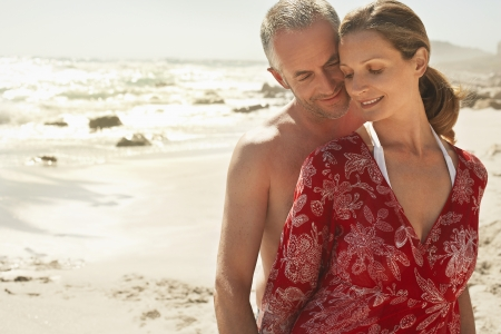 early 40s: Affectionate Couple on Beach