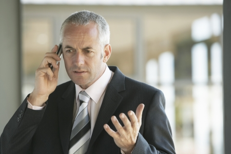 decisionmaking: Businessman Using Cell Phone