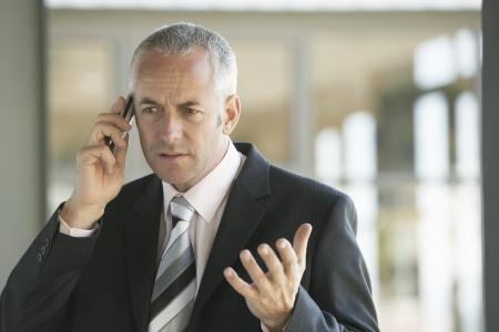 problemsolving: Businessman Using Cell Phone