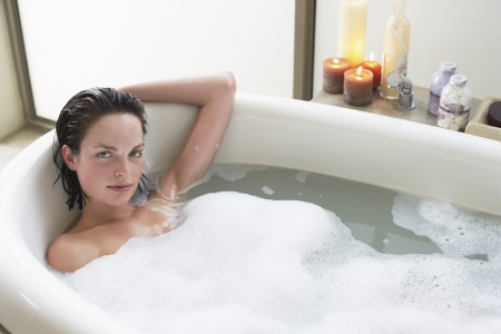 elevated view: Young woman relaxing in bubble bath elevated view