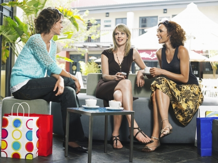 table skirt: Three female friends talking in cafe
