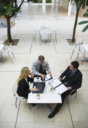 elevated view: Three businesspeople working outdoors elevated view
