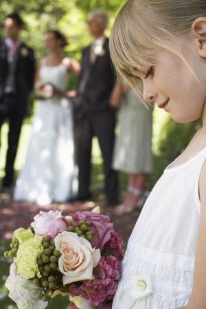 one person with others: Flower Girl Outdoors