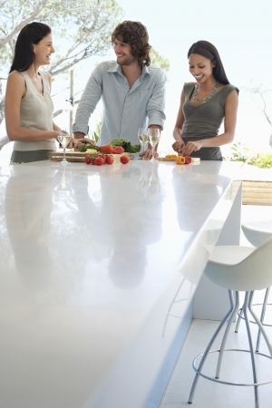 kitchen counter: Friends socialising at end of outdoor counter at Dinner Party