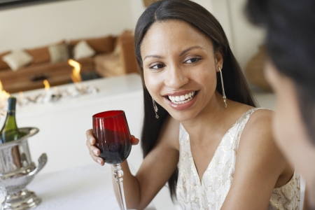 formal dinner party: Young Woman Drinking Wine socialising at formal dinner party LANG_EVOIMAGES
