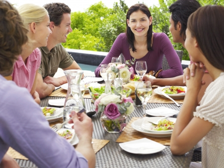 Friends eating drinking and socialising at table outdoors Stock Photo - 19546283