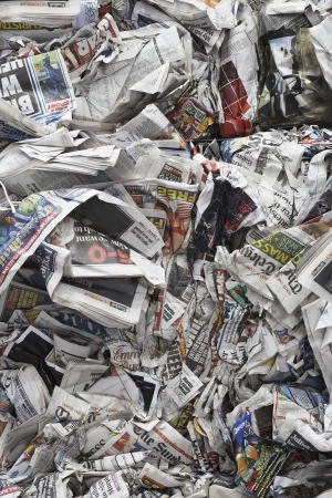 scrunched: Pile of scrunched up newspapers full frame