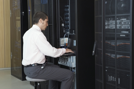 server side: Technician working in server room