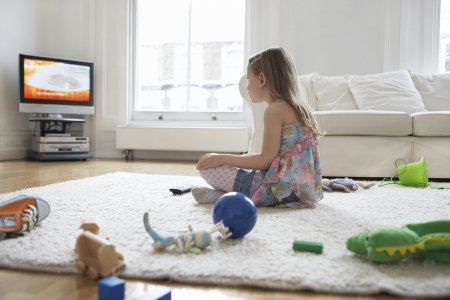messy: Girl Watching Television in Messy Living Room