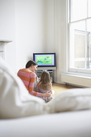 mundane: Mother and Daughter Watching Television