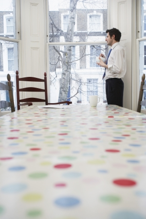 bussiness time: Businessman Eating Cereal in Dining Room LANG_EVOIMAGES